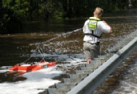 USGS hydrologic technician Erik Ohlson measures the discharge of the Suwannee River floodwaters coming over US highway 90 near Ellaville, Florida. (Saturday, April 11, 2009)